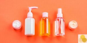 Lotions on orange background